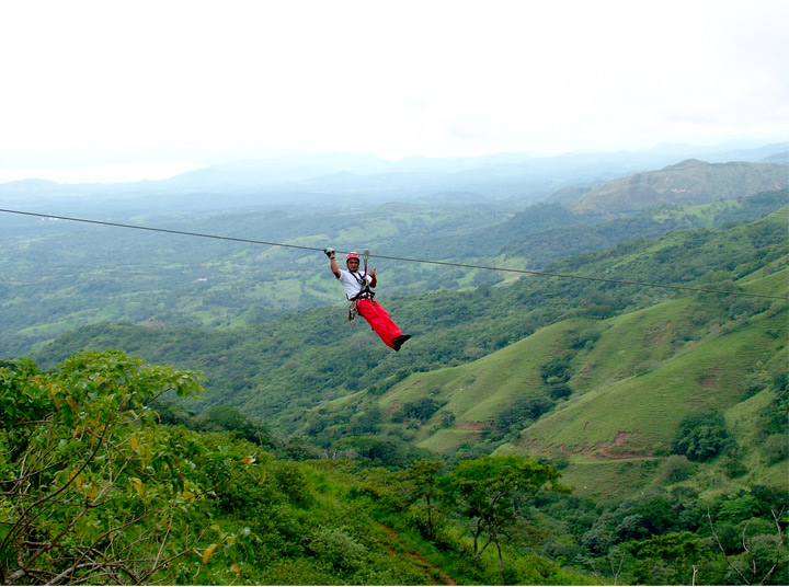 Costa Rica Superman zip line  tour in Finca Daniel adventure park image 2
